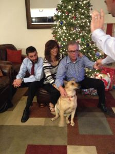 Trying to get a family photo on Christmas Eve... we bribe the dogs with food.