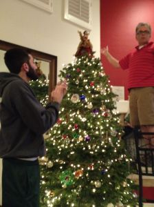 Alex giving approval on my dad's placement of the angel