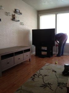 Unplugging the TV from its old spot