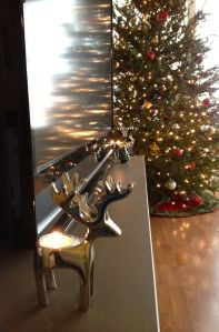 Reindeer candle holders on our TV stand