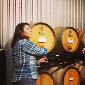 Maureen serving us wine from the barrels