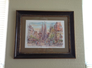 A framed print of La Sagrada Familia that we bought in Barcelona