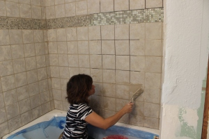 Mom working on the grout