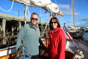 My parents on our sailboat
