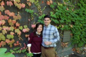 We loved the backdrop of the different colored leaves, but no one was around to take our picture. Soooo we strapped my camera to a tree branch and used the timer to take a picture. I'm so bummed this one came out blurry, I think it would have been great!