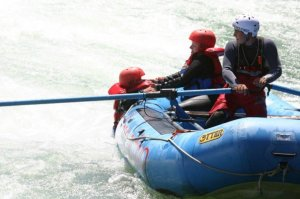 Being lifted back into the raft
